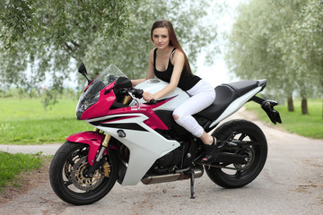 young girl with a sports motorcycle