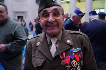 World War II veteran Gasparre poses for a photo following a Purple Heart Reunification ceremony on Purple Heart Day in Manhattan
