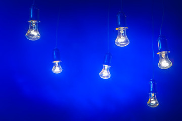 Blue light bulb. Old light bulbs with wires.