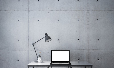 3D interior rendering design of working table and notebook computer and concrete wall texture
