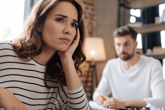 Depressed cheerless woman thinking about her problems