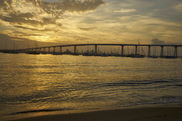 Coronado Bay, San Diego, California welcomes another beautiful day as the sun bathes everything in a warm golden light