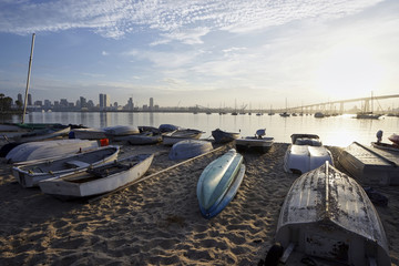 dinghys beached on a sand at daybreak on Coronado Island
