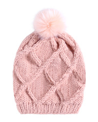 Pale pink winter knitted cap hat with a pom-pom isolated white