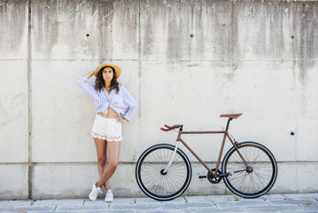 Woman standing at bike