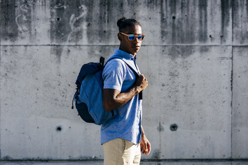 Cheerful man with backpack