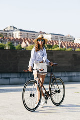 Woman with bicycle on street