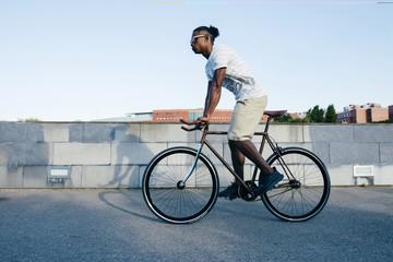 Black man riding bicycle