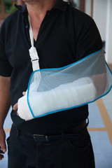 Man with a plaster because broken arm.