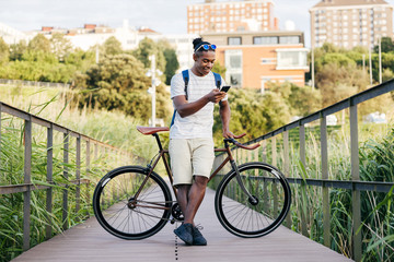 Man with bike use his phone