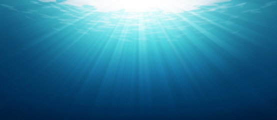 Underwater blue sea background photo with with sun and sunlight shining under the sea.