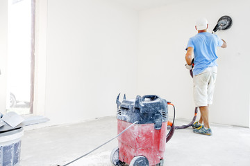 Drywall sanding. Drywall sanders, drywall sanding tool. worker using drywall sanders and polishing.