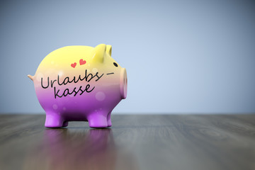 piggy bank with the word holiday fund in german language