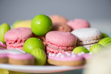 Spoed Foto op Canvas Macarons close-up view of delicious colorful sweets at birthday party