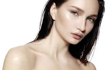 Beautiful Face of young Woman. Skincare, Wellness, Spa. Clean soft Skin, Fresh look. Natural daily makeup, wet hair