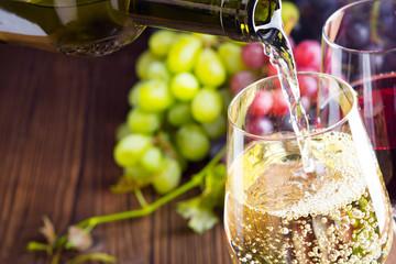 Pouring white wine into a wine glass