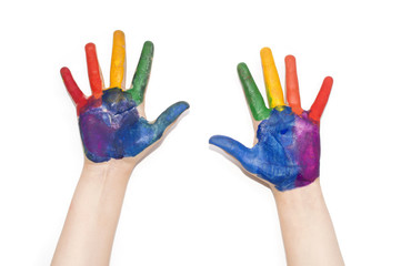 Children's hands painted with colorful paint.