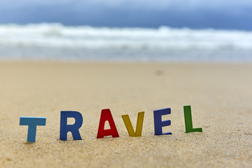 TRAVEL wood letters on the beach