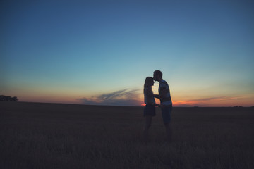 Young couple enjoying outdoors in the field.