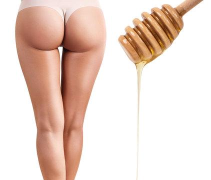 Body depilation by honey or sugar pasta.