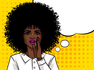 Young attractive Afro american girl wants to tell a secret. Portrait of a woman with dark skin and curly hair. Girl holding a hand near mouth.