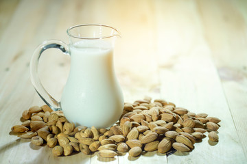 almond and almond milk on black background