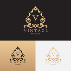 Vintage premium brand logo template. Vector symbol with floral ornament. Logotype for uses in fashion spheres, hotel and restaurant business and jewelry industry.