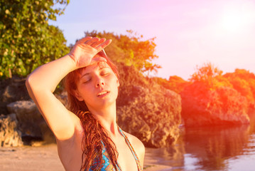Young woman with heatstroke. Dangerous sun. Beach life. Girl under sun.