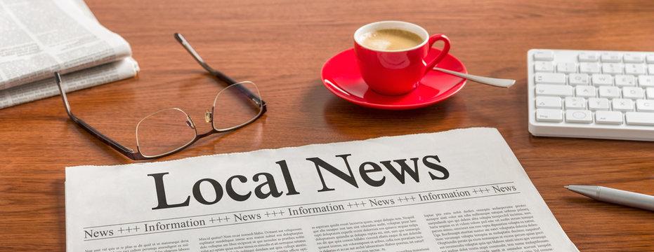 A newspaper on a wooden desk - Local News