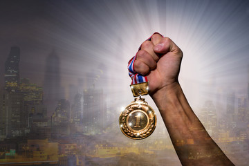 Winner holding golden medal for show and celebrate number one
