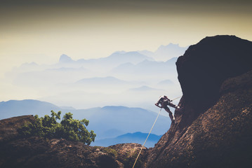 Climber against mountain valley. Instagram stylization