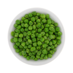 Green peas in a white bowl isolated on a white background.