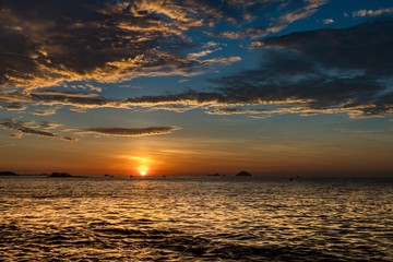 Nha Trang Vietnam sunrise with a dramatic cloudy blue orange sky over the south China sea.