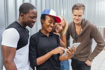 Happy Group of Friends Using a Digital Tablet Outdoor