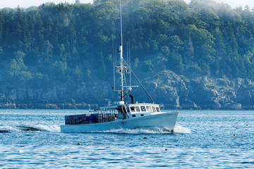 A lobster boat heads out to set his traps