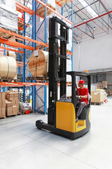 Forklift with cable spool in warehouse