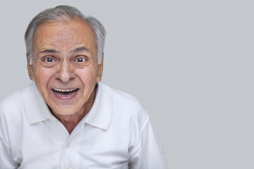 Portrait of cheerful over gray background