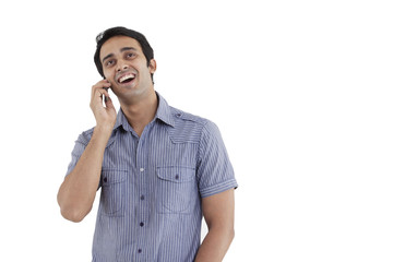 Man laughing while having conversation on phone