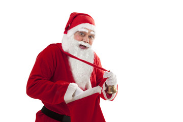 Portrait of happy Santa removing something from bag over white background