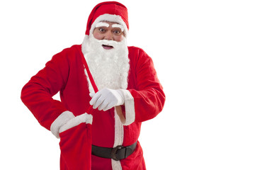 Portrait of Santa Claus removing gift from bag over white background
