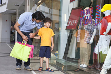 Father and son out for shopping in a mall