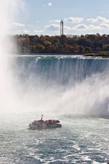 Beautiful image with amazing Niagara waterfall and a ship in the mist