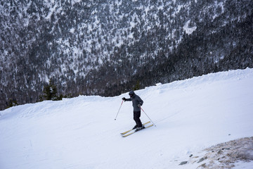 High angle view of man skiing on snow covered hill