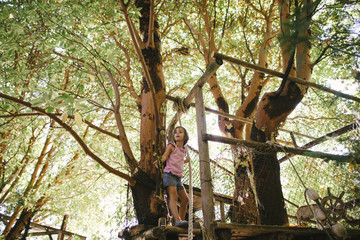 Girl standing at tree house