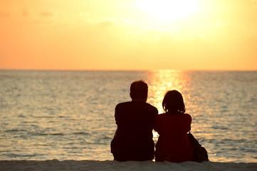 Lover honeymoon on the sunset beach