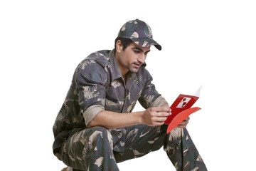 Smiling soldier reading greeting card