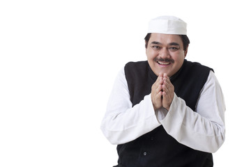 Smiling politician with hands clasped