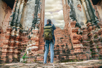 Young asian traveller enjoying a looking at Buddhist stupas in thailand asia. Burma Asia. Traveling along Asia active lifestyle tourist thailand concept