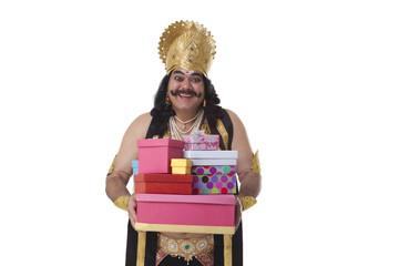 Man dressed as Raavan holding gifts
