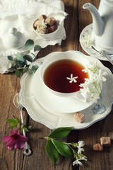 Vintage style: Tea drinking with jasmine tea. Toned image